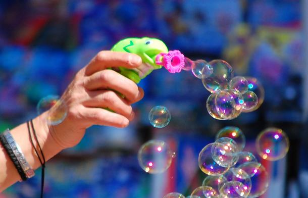 Making-soap-bubbles-with-a-toy-gun398